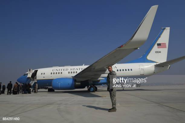 A US soldier sands guard near the airplane after US Secretary of State Rex Tillerson arrived at US Osan Air Base in Pyeongtaeck on March 17 2017...
