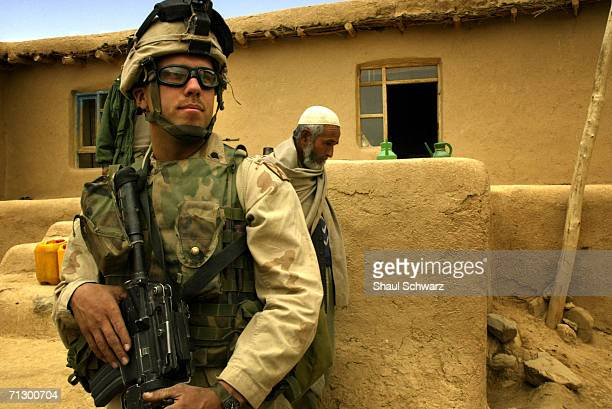 US soldier secures a house where his commander stopped to have tea with a local elder on April 17 2004 in Ghazni Afghanistan Soldiers of the US...