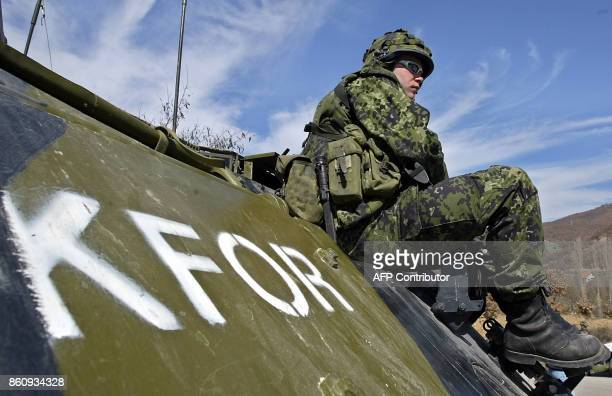A KFOR soldier sits on an armoured vehicle as UN troops block all access to the ethnic Albanian village of Cabra 10km west of the flashpoint city of...