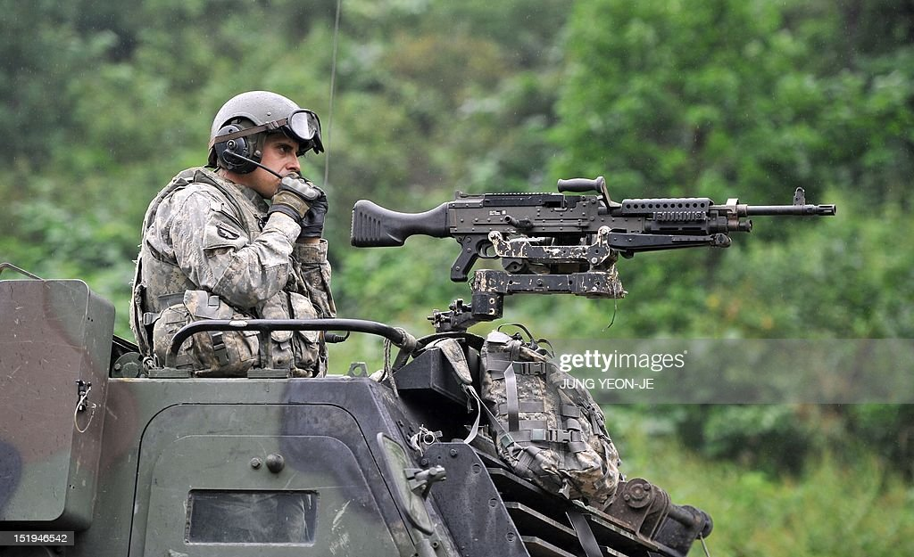 A US soldier sits on the top of Multiple Launch Rocket System (MLRS) during a live fire training exercise in the South Korean border county of Cheorwon on September 13, 2012. Some 28,500 US troops are based in South Korea under a mutual defence pact to deter against the North Korean threat. The two Koreas have been technically at war since the conflict ended in an armistice, without a subsequent peace treaty being signed.