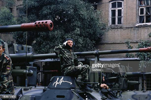 Soldier Sitting On An Armored Personnel Carrier And Saluting During A Military Parade In Yerevan Armenia 2003