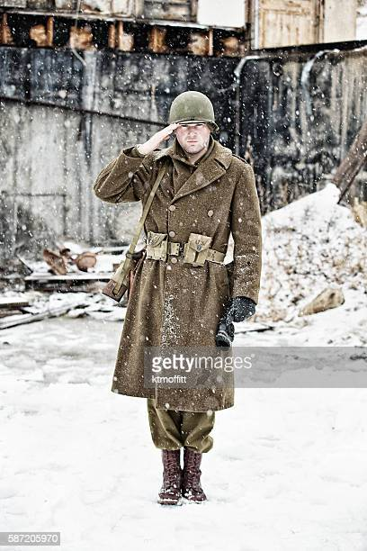 WWII US Soldier Standing At Attention and Saluting