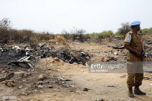 A UN soldier stands at the crash site of the Air Algerie Flight AH 5017 in Mali's Gossi region west of Gao on July 26 2014 UN experts investigating...