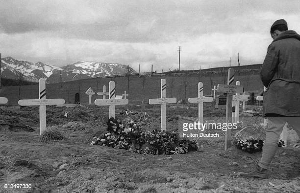 A soldier stands before the graves of allied soldiers killed in the Norway campaign July 1940
