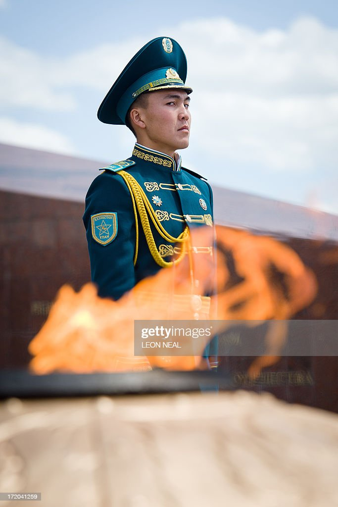 A soldier stands guard ahead of a wreath-laying ceremony by British Prime Minister David Cameron at the Monument of the Motherland Defenders in Astana, Kazakhstan on July 1, 2013. David Cameron arrived in Kazakhstan on June 30, 2013 on the first ever trip by a serving British prime minister, hoping to boost trade ties but also promising to raise human rights concerns.