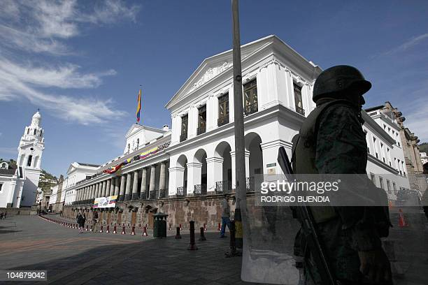 A soldier stands guard around the Carondolet presidential palace in Quito October 1 2010 President Rafael Correa on Friday made a triumphant return...