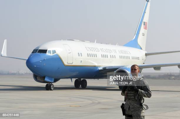 A US soldier stands guard as the airplane carrying US Secretary of State Rex Tillerson arrives at US Osan Air Base in Pyeongtaeck on March 17 2017...