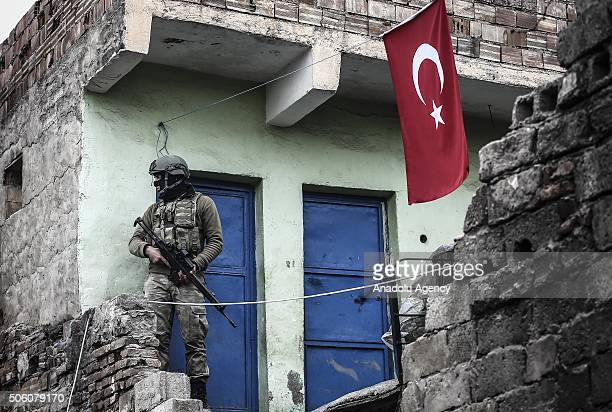 A soldier stands guard at a neighborhood as Turkish Security Forces carry out a counter terrorism operation against terrorist organization PKK in...