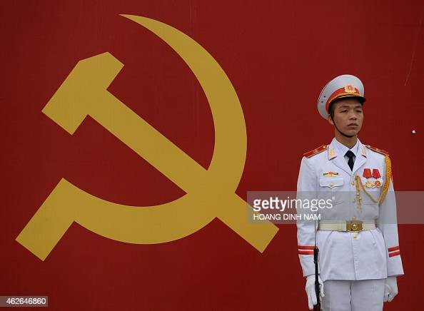 A soldier stands guard at the entrance gate to the National Convention Center where Communist Party members have gathered for an official meeting...