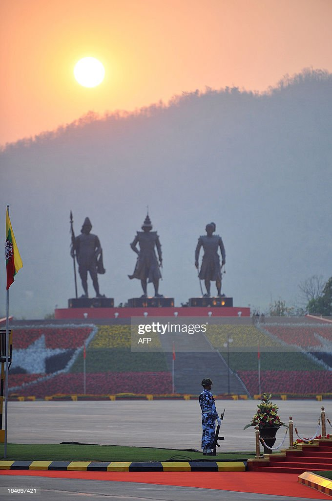 A soldier stands guard during a ceremony marking Myanmar's 68th Armed Forces Day at a parade ground in Naypyidaw on March 27, 2013. Opposition leader Aung San Suu Kyi attended Myanmar's Armed Forces Day for the first time. AFP PHOTO / Ye Aung THU