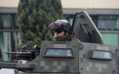 A soldier stands guard in a gunship vehicle before the presentation of Juan Manuel Rodriguez Garcia aka 'Juan Perros' an alleged leader of the Gulf...