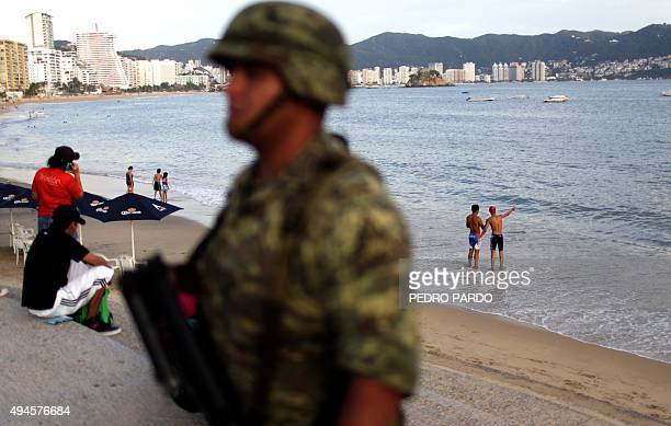 A soldier stands guard in a touristic area of Acapulco in the Mexican state of Guerrero on October 27 2015 Acapulco once known as a celebrities...