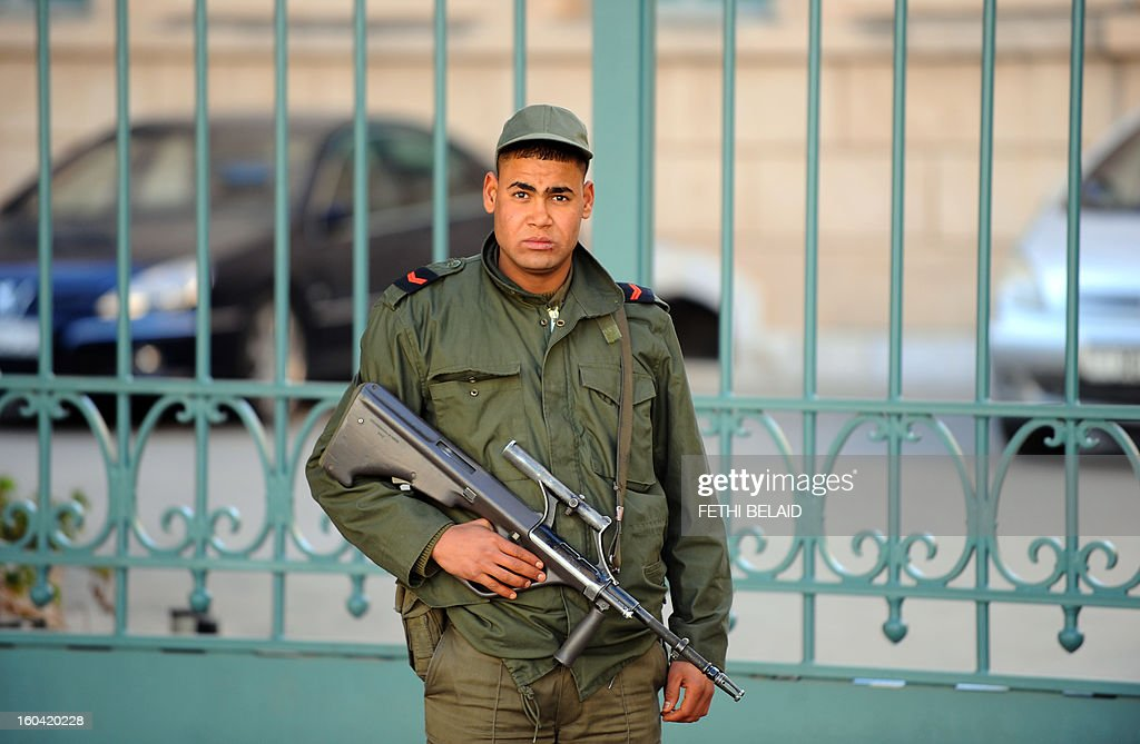 A soldier stands guard in front of the French embassy on January 31, 2013 in Tunis, as security measures are reinforced as part of the ongoing state of emergency which has been declared since the fall of ex-president. Tunisian President Moncef Marzouki should decide today wether to continue the state of emergency or not.