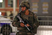 A soldier stands guard near the site of an attack in the French Riviera town of Nice after a truck that ploughed into a crowd leaving a fireworks...