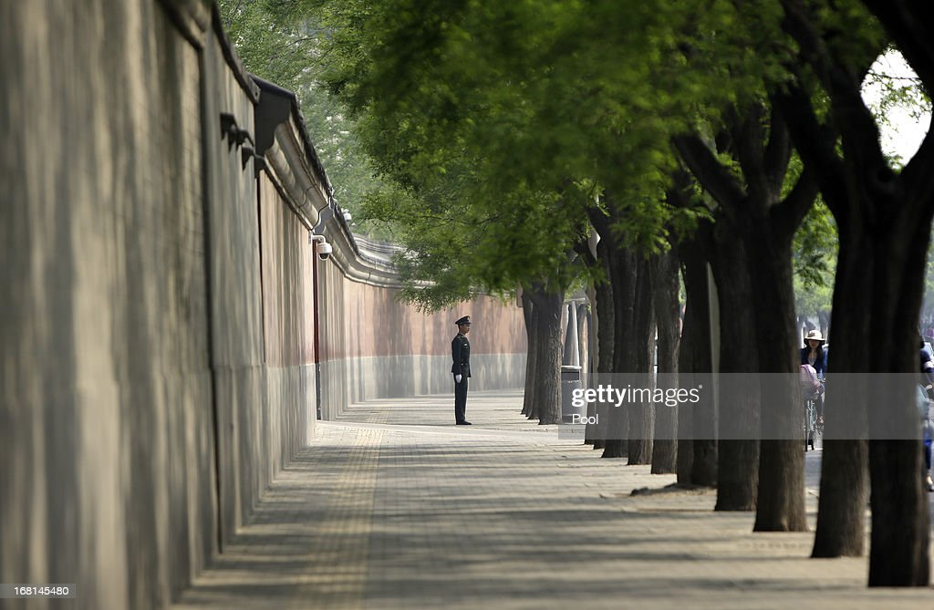 A soldier stands guard next to a red wall of the Zhongnanhai leadership compound ahead of a meeting between China's Premier Li Keqiang and...