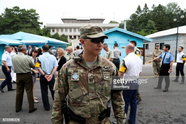 A US soldier stands guard while attendees gather at an event to commemorate the 64th Anniversary of the Korean War Armistice Agreement at the truce...