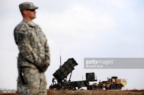 A US soldier stands in front of a Patriot missile system at a Turkish military base in Gaziantep on February 5 2013 The United States Germany and the...