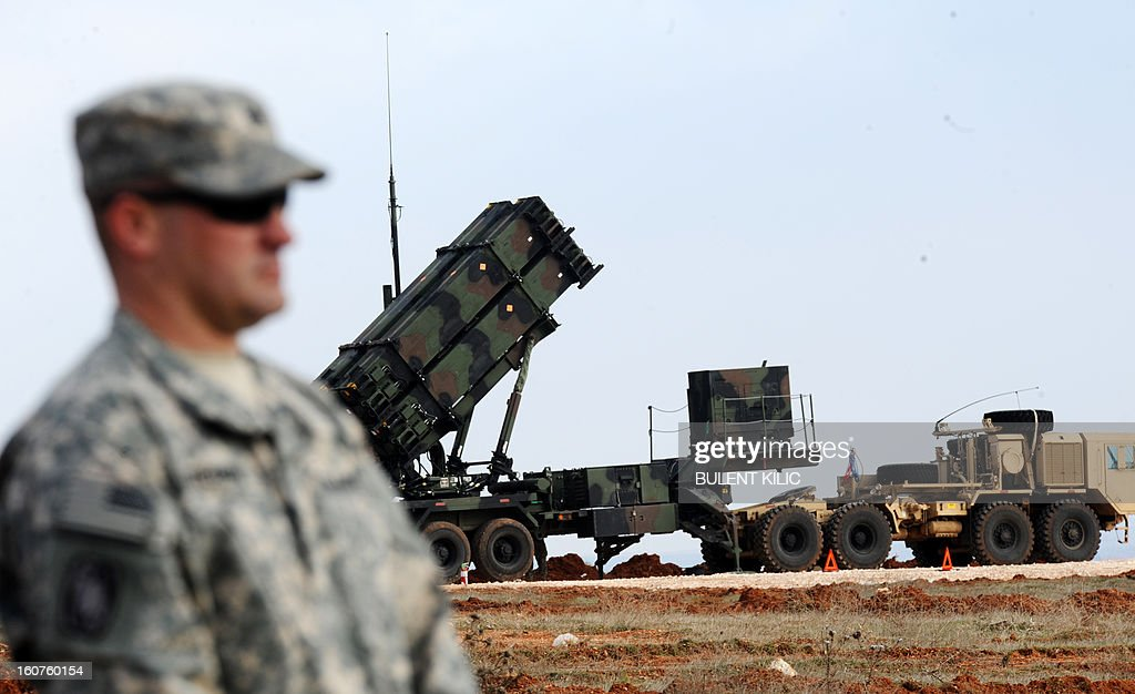 A US soldier stands in front of a Patriot missile system at a Turkish military base in Gaziantep on February 5, 2013. The United States, Germany and the Netherlands committed to send two missile batteries each and up to 400 soldiers to operate them after Ankara asked for help to bolster its air defences against possible missile attack from Syria. AFP PHOTO / BULENT KILIC