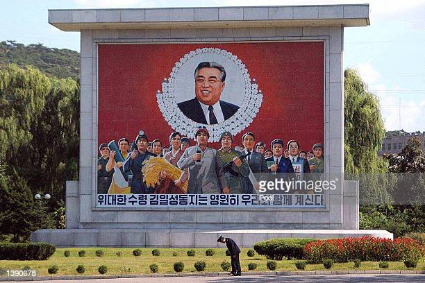A soldier stands in front of a portrait of former North Korean leader Kim Il Sung September 16 2002 in Pyongyang North Korea The country recently...