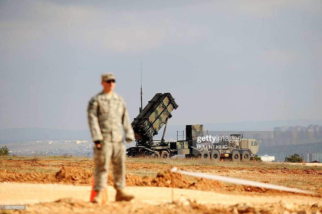A US soldier stands near a Patriot missile system at a Turkish military base in Gaziantep on February 5, 2013. The United States, Germany and the Netherlands committed to send two missile batteries each and up to 400 soldiers to operate them after Ankara asked for help to bolster its air defences against possible missile attack from Syria.