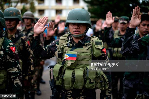 A soldier takes an oath during a flag raising ceremony at the Lanao Del Sur provincial capital of Marawi on the southern island of Mindanao on June...