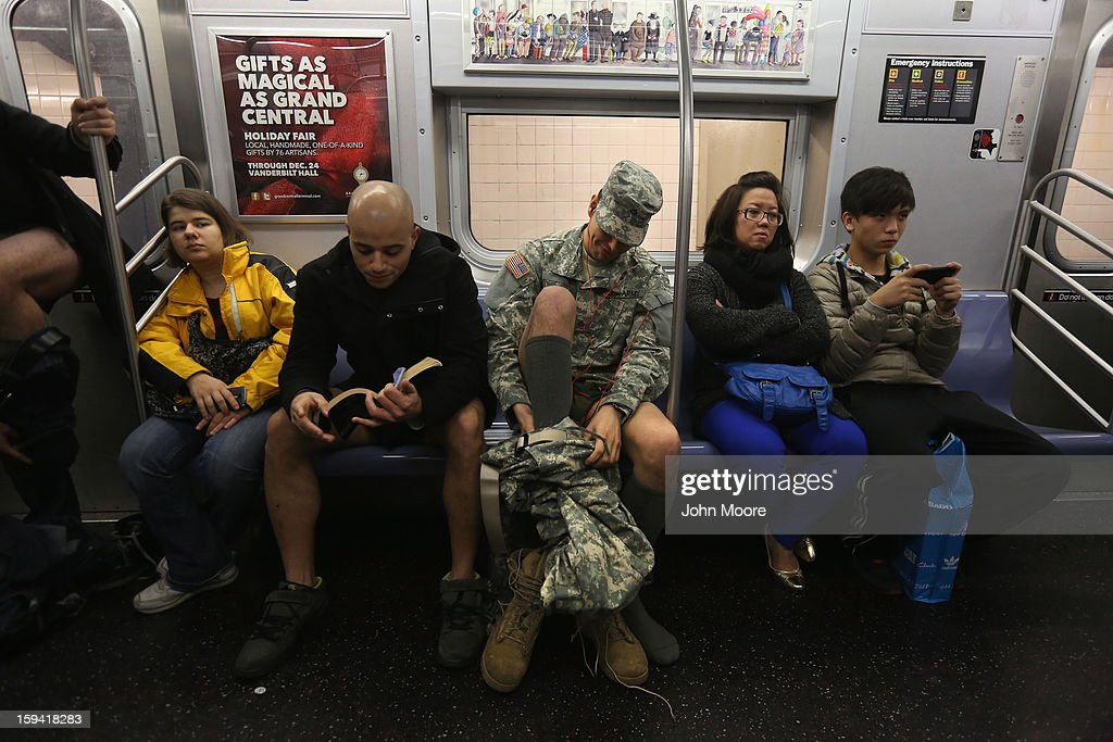 A soldier takes off his pants while riding the subway on January 13, 2013 in New York City. He and thousands of others participated in the 12th annual No Pants Subway Ride, organized by New York City prank collective Improv Everywhere. During the afternoon event, participants boarded separate subway stops and removed their pants, pretending that they did not know each other. The event, refered to as a 'celebration of silliness' is designed to make fellow subway riders laugh and smile.