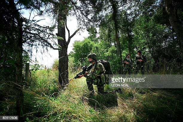 A soldier takes part in a mission rehearsal exercise by the 3 Commando Brigade on Salisbury Plains Wiltshire southern England ahead of their August...