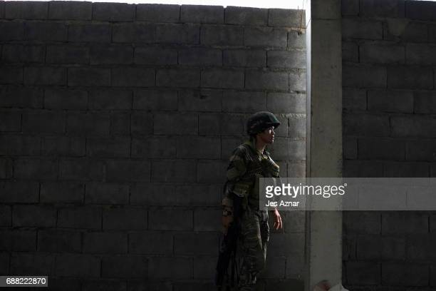 A soldier taking a look at enemy positions as they try to clear the city of armed militants one street at a time on May 25 2017 in Marawi city...