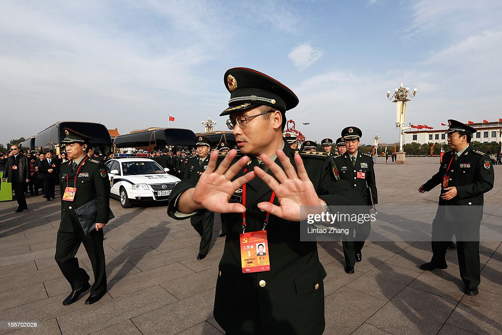 A soldier try to prevent photos taken at Tiananmen Square on November 7, 2012 in Beijing, China. The18th National Congress of the Communist Party of China (CPC) is proposed to convene on November 8 in Beijing.