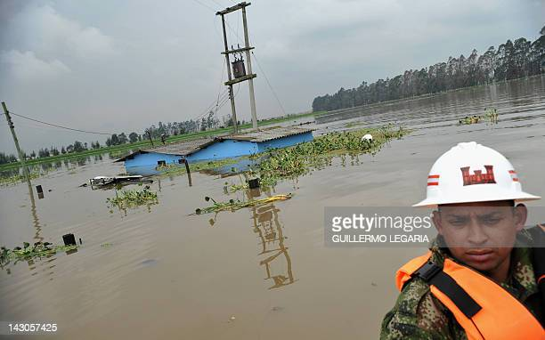 A soldier uses a boat to move around the flooded municipality of Cota outskirts of Bogota Colombia on April 18 2012 Up to now the first rainy season...