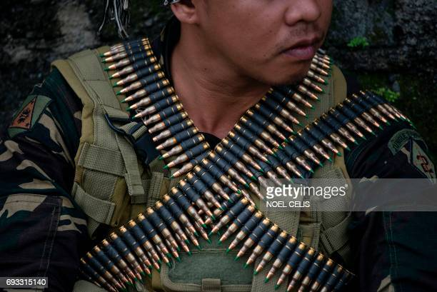 TOPSHOT A soldier waits before conducting housetohouse clearing operations against Islamist militants in Marawi on the southern island of Mindanao on...