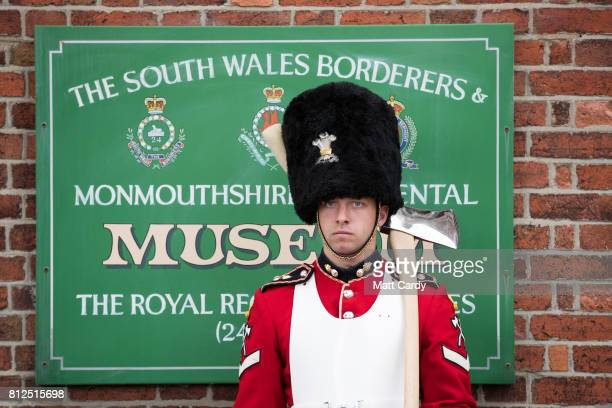 A soldier waits for the arrival of Prince Charles the Prince of Wales as he visits the Royal Welsh Regimental Museum during The Prince of Wales'...