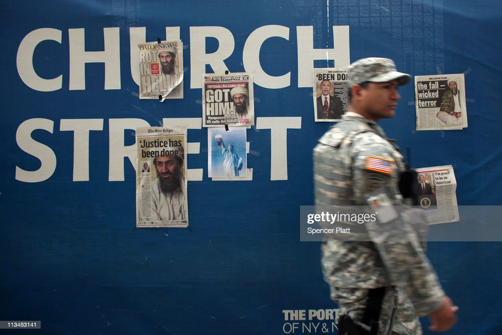 S. soldier walks by newspaper clippings on a wall at Ground Zero heralding the death of Osama Bin Laden on May 2, 2011 in New York City. President Barack Obama announced the death of Osama bin Laden during a late night address to the nation from the White House in Washington on May 1. The mastermind of the September 11 terrorist attacks was killed in an American military operation at a compound in Pakistan.