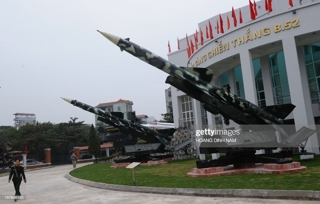A soldier walks past two Soviet-made SAM-2 missiles on display at the museum 'Victory over B.52s' in Hanoi on December 7, 2012. Vietnam has been launching celebrations marking the 40th anniversary of 'Dien Bien Phu in the air' recalling Hanoi's battle against US massive bombing campaign carried out by the US Airforce strategic bombarders B-52 in December 1972. Vietnamese Northern forces have claimed downing at that time some thirty four B-52 aircrafts. As part of a propaganda programme on the event, Hanoi has organised workshops and exhibitions. AFP PHOTO/HOANG DINH Nam