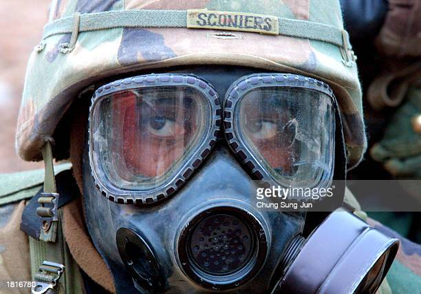 S soldier wears a gas mask as he takes part in a chemical biological and radiological warfare exercise February 26 2003 in Yonchon near the...