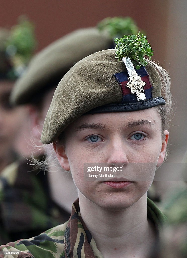 A soldier wears the the traditional sprigs of shamrock which is presented by the Catherine, Duchess of Cambridge and Prince William, Duke of Cambridge at the St Patrick's Day parade on March 17, 2013 in Aldershot, England.