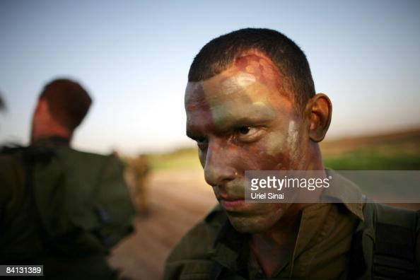 A soldier with camouflage colors on his face prepares for action as Israeli army special forces are deployed on December 28 2008 at the Gaza Israel...
