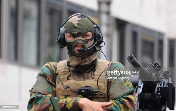A soldier with camouflage patterned cloth is seen as Belgium military units attend the parade as part of ceremonies marking Belgium's National Day on...
