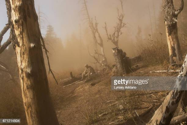 A soldier with the 173rd battle company sits alone in the dust of a medevac helicopter after the helicopter airlifted out the body of one of his...