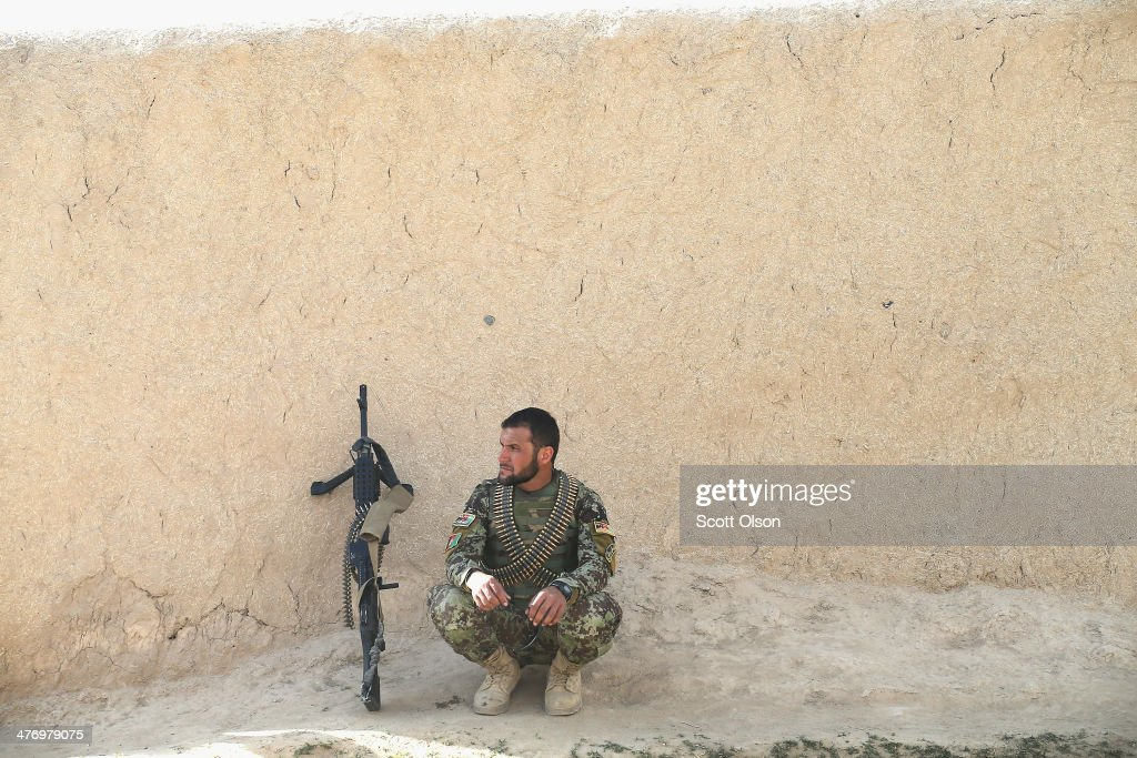 A soldier with the Afghan National Army (ANA) keeps watch during a patrol through a village March 5, 2014 near Kandahar, Afghanistan. President Obama recently ordered the Pentagon to begin contingency planning for a pullout from Afghanistan by the end of 2014 if Afghanistan President Hamid Karzai or his successor refuses to sign the Bilateral Security Agreement.
