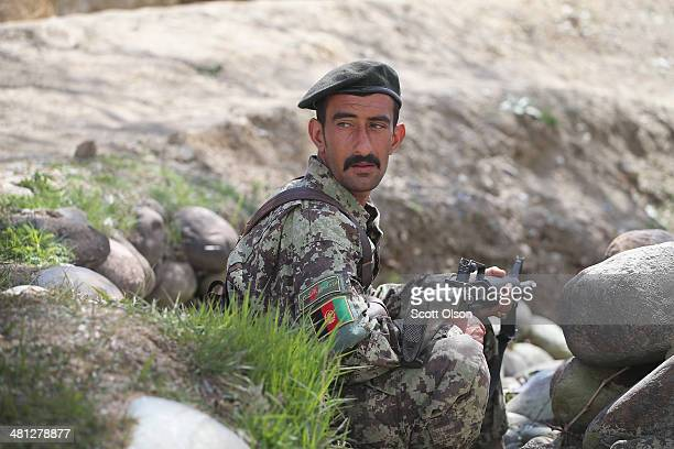 A soldier with the Afghan National Army keeps watch during a patrol with soldiers from the US Army's 2nd Battalion 87th Infantry Regiment 3rd Brigade...