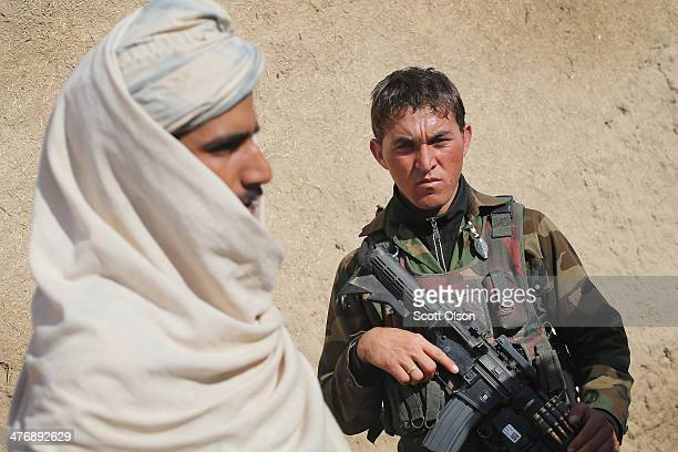 A soldier with the Afghan National Army patrols through a village March 5 2014 near Kandahar Afghanistan President Obama recently ordered the...