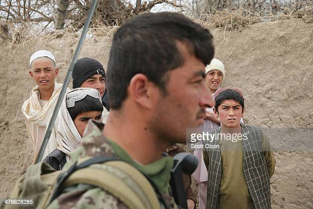 A soldier with the Afghan National Army patrols through a village with soldiers from the US Army's 4th squadron 2d Cavalry Regimentsit on March 4...