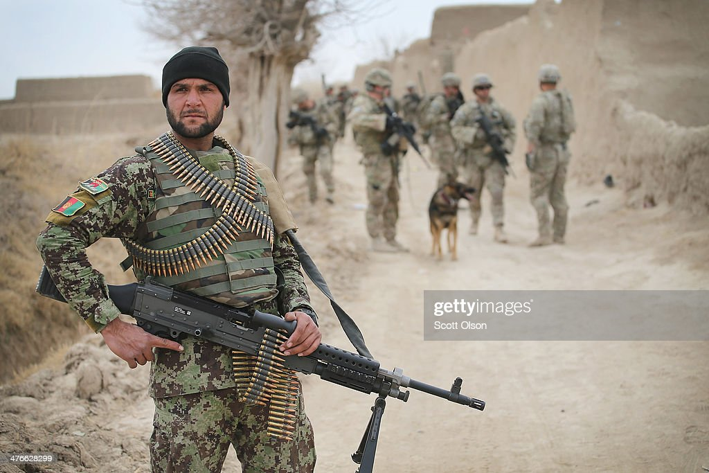 A soldier with the Afghan National Army (ANA) patrols through a village with soldiers from the U.S. Army's 4th squadron 2d Cavalry Regimentsit on March 4, 2014 near Kandahar, Afghanistan. President Obama recently ordered the Pentagon to begin contingency planning for a pullout from Afghanistan by the end of 2014 if Afghanistan President Hamid Karzai or his successor refuses to sign the Bilateral Security Agreement.