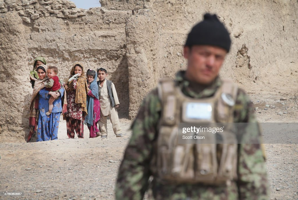 A soldier with the Afghan National Army (ANA) walks through a village during a joint patrol with the U.S. Army's 4th squadron 2d Cavalry Regiment on March 2, 2014 near Kandahar, Afghanistan. President Obama recently ordered the Pentagon to begin contingency planning for a pullout from Afghanistan by the end of 2014 if Afghanistan President Hamid Karzai or his successor refuses to sign the Bilateral Security Agreement.