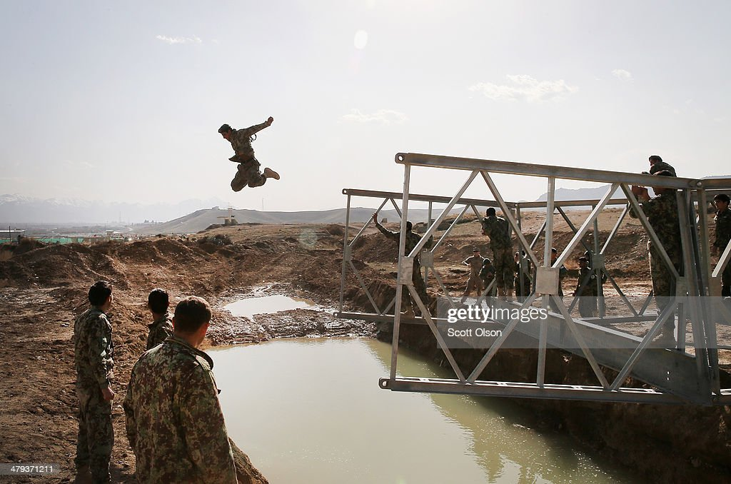 A soldier with the Afghan National Army's (ANA) National Engineer Brigade tries to make dry land after leaping from the top of a Mabey-Johnson portable pre-fabricated bridge which his unit was learning to construct with the help of U.S. Navy Seabees from Naval Mobile Construction Battalion (MCB) 28 at the ANA's combined Fielding Center on March 18, 2014 in Kabul, Afghanistan. The Seabees are attached to the U.S. Army's 130th Engineer Brigade are responsible for training ANA soldiers various engineering tasks at the facility. In a recent speech to his country's parliament, Afghan President Hamid Karzai said U.S. troops can leave Afghanistan at the end of the year because his military was ready to take over responsibility for the nation's security.