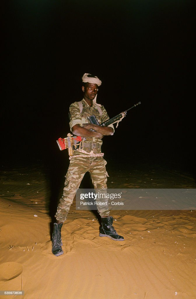 A soldier with the Forces Armees Nationales Chadiennes (FANT), or National Army of Chad, stands guard with an assault rifle at Wadi Doum. The FANT mission in early 1987 was to reconquer the Borkou-Ennedi-Tibesti Prefecture and recover the territory in northern Chad that had been under Libyan control.