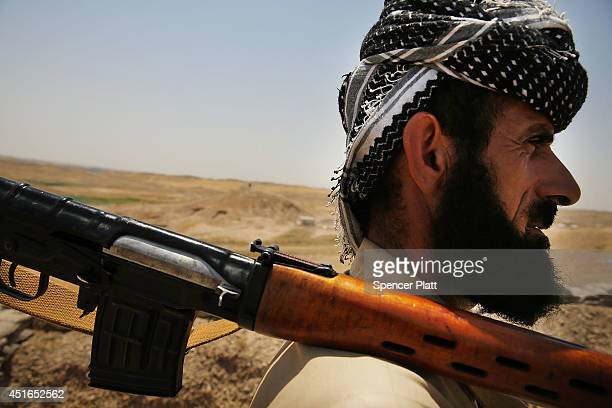 A soldier with the Kurdish peshmerga pauses at an outpost on the edges of the contested city of Kirkuk on July 3 2014 in Kirkuk Iraq On Thursday the...