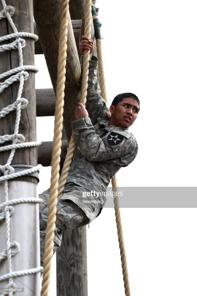 A soldier with the U.S. Army's Second Infantry Division climbs up an obstacle during an air assault training course at Camp Casey in Dongducheon, South Korea, on Tuesday, Feb. 26, 2013. The U.S. has 28,500 soldiers in South Korea as a legacy of the 1950-53 Korean War, which ended in a cease-fire that left the two Koreas technically still at war. Photographer: SeongJoon Cho/Bloomberg via Getty Images