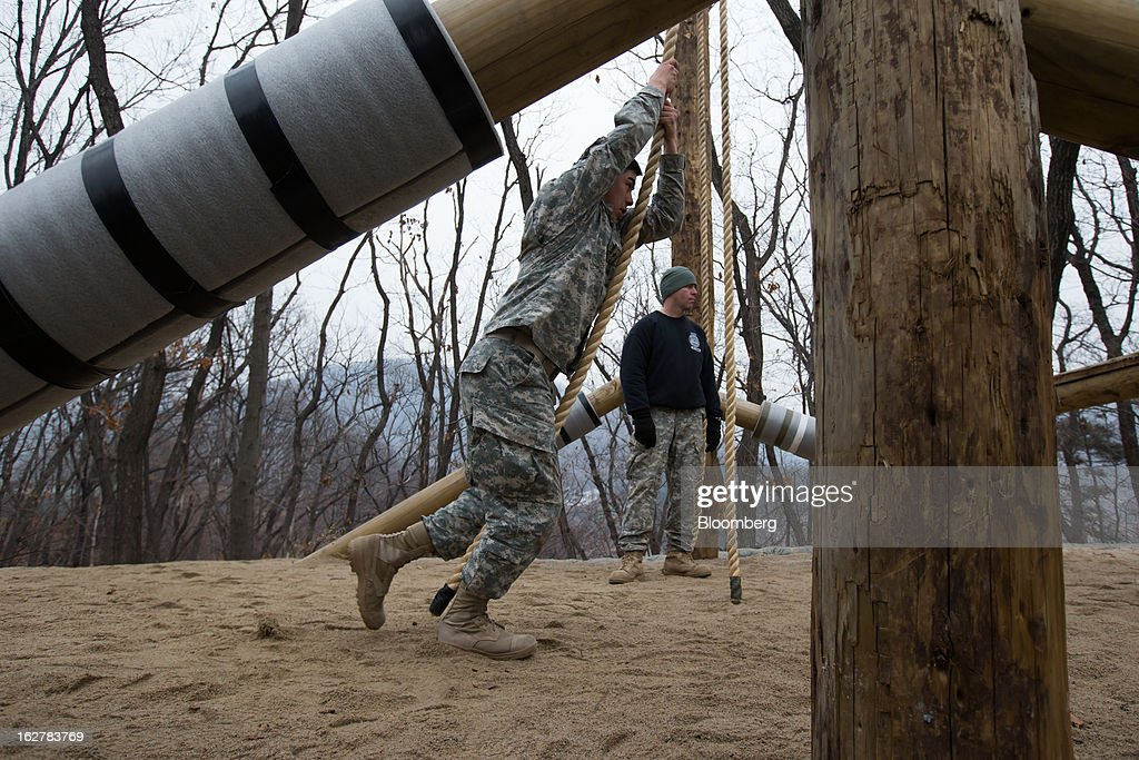 A soldier with the U.S. Army's Second Infantry Division prepares to climb up an obstacle during an air assault training course at Camp Casey in Dongducheon, South Korea, on Tuesday, Feb. 26, 2013. The U.S. has 28,500 soldiers in South Korea as a legacy of the 1950-53 Korean War, which ended in a cease-fire that left the two Koreas technically still at war. Photographer: SeongJoon Cho/Bloomberg via Getty Images